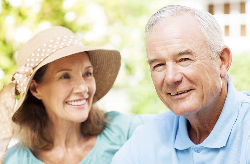 Close-up portrait of senior couple smiling in Aged Care